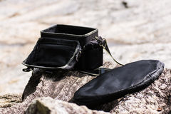 Camera bag And Reflection on Stone Royalty Free Stock Image