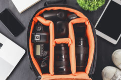 Camera in bag on top view ready to go travel concept. Camera gear in bag on top view ready to go travel concept Royalty Free Stock Image