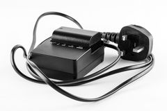 Camera battery charger Royalty Free Stock Photography
