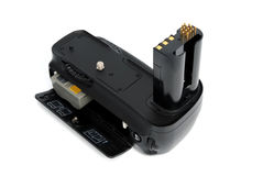 Camera battery grip. Battery grip for dslr cameras on white background Stock Images