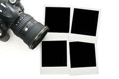 Camera with blank polaroid frames. Isolated on white Royalty Free Stock Photography