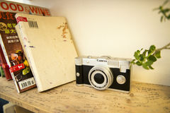 The camera. The book and cameras on the shelf Royalty Free Stock Photo