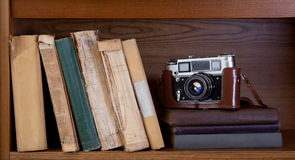 Camera and book. Vintage camera and old books on a shelf Stock Photo