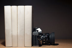 Camera and books. Vintage camera and old books Stock Image