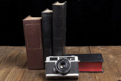 Camera With Books Stock Images