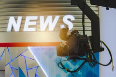 Camera in broadcast news room. stock images