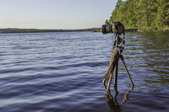 Camera and calm waves Royalty Free Stock Photo