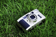 Camera. S that use film as a grass background Royalty Free Stock Image