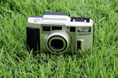 Camera. S that use film as a grass background Royalty Free Stock Photography