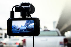 The Camera in Car. A camera in car has on and recording for the traffic jam with lighting of sunrise in the morning Royalty Free Stock Photos