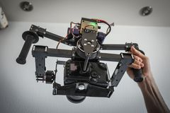 Camera carbon gimbal with dslr camera with man hands. Selfmade technology Royalty Free Stock Photography