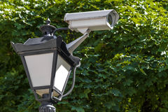 Camera cctv on top of street lantern royalty free stock photos