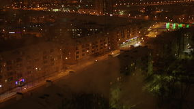 Camera Changes Focus from Flow to Clear and Shows Night Avenue. Camera changes focus from flow to clear and shows brightly lit night avenue among large modern stock video