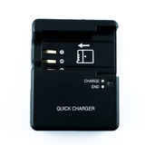 Camera charger battery Stock Image