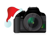 Camera and christmas hat gift concept Royalty Free Stock Photo