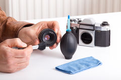 Camera cleaning Royalty Free Stock Photography