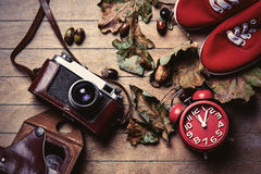 Camera, clock and gumshoes Royalty Free Stock Photo