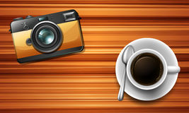 Camera and a coffee on table Stock Photo
