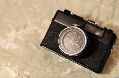 Camera compass at the map. Film camera compass lens at the paper map Royalty Free Stock Photo