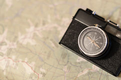 Camera compass at the map. Film camera compass lens at the paper map Royalty Free Stock Images
