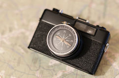 Camera compass at the map. Film camera compass lens at the paper map Stock Images