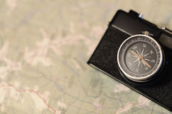 Camera compass at the map. Film camera compass lens at the paper map Stock Photos