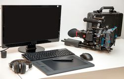 Camera, computer and tablet for video editing. A camera, computer and tablet for video editing Royalty Free Stock Photography