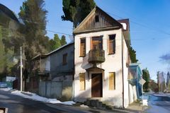 Camera con architettura antica e un balcone in una via stretta di Sukhumi Immagine Stock