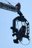 Camera on crane-3. Tv camera on crane in use on sport event Royalty Free Stock Photography