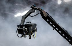 Camera on crane shooting in a stadium Royalty Free Stock Images