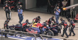 Camera Crew covering Red Bull Pit Stop. Camera Crew Duo covers a Red Bull Formula 1 Car Pit Stop royalty free stock photography
