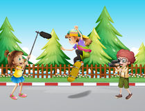 Camera crew filming girl skateboarding in park. Illustration Stock Image
