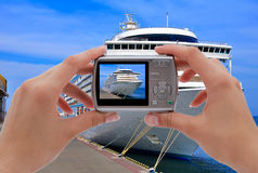 Camera  and cruise liner Stock Image