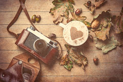 Camera and cup of coffee Royalty Free Stock Images