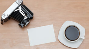 Camera and a cup of coffee Stock Photos
