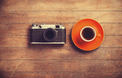 Camera and cup Royalty Free Stock Photo