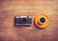 Camera and cup Stock Photos