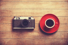Camera and cup Stock Image