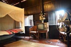 Camera da letto in casa tailandese tradizionale nella regione settentrionale fotografie stock