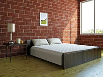 Camera da letto con un grande letto Immagine Stock