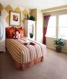 Camera da letto della ragazza Fotografia Stock