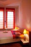 Camera da letto rossa di tonalità Fotografia Stock