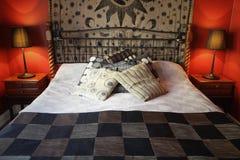 Camera da letto rustica calda Fotografia Stock Libera da Diritti
