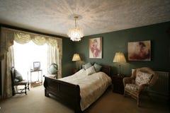 Camera da letto verde Fotografie Stock