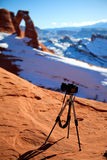 Camera at delicate arch Royalty Free Stock Photos