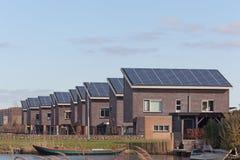 Camera della famiglia con i comitati solari Immagini Stock Libere da Diritti
