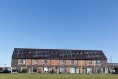 Camera della famiglia con i comitati solari Immagine Stock