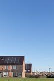 Camera della famiglia con i comitati solari Fotografia Stock Libera da Diritti