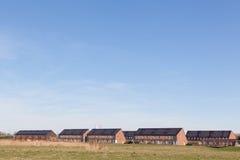 Camera della famiglia con i comitati solari Fotografie Stock Libere da Diritti