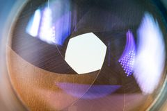 Camera diaphragm aperture with flare and reflection on lens Royalty Free Stock Photos